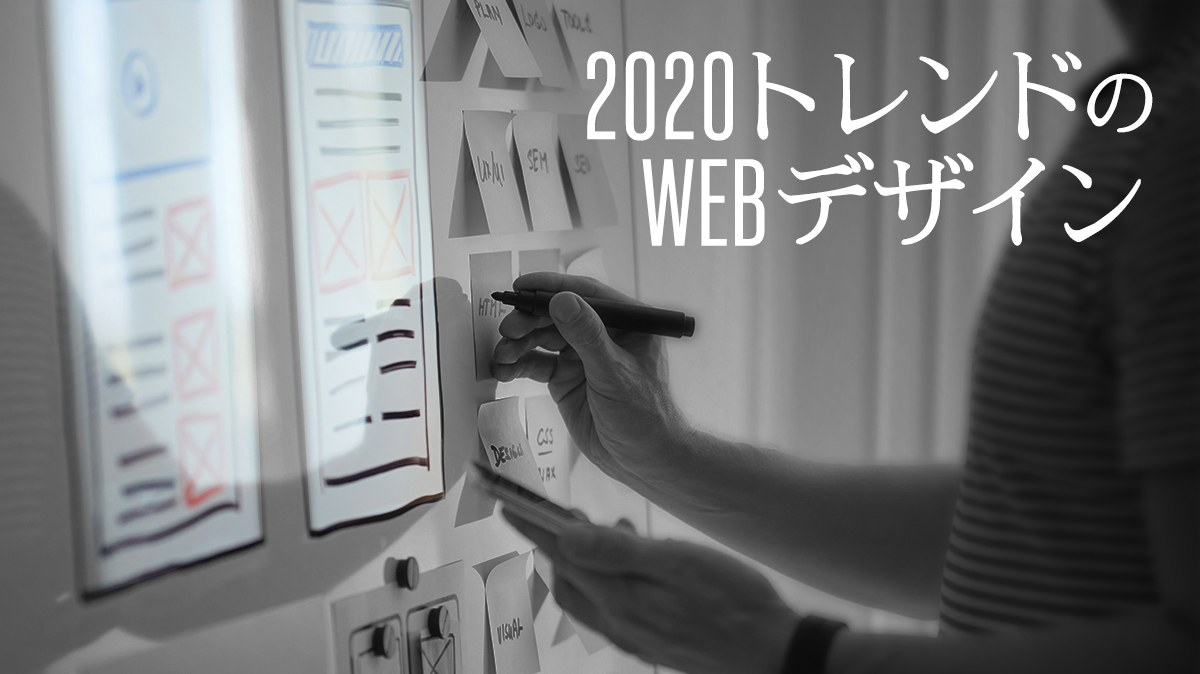 men drawing sketch on white board about ui design website design