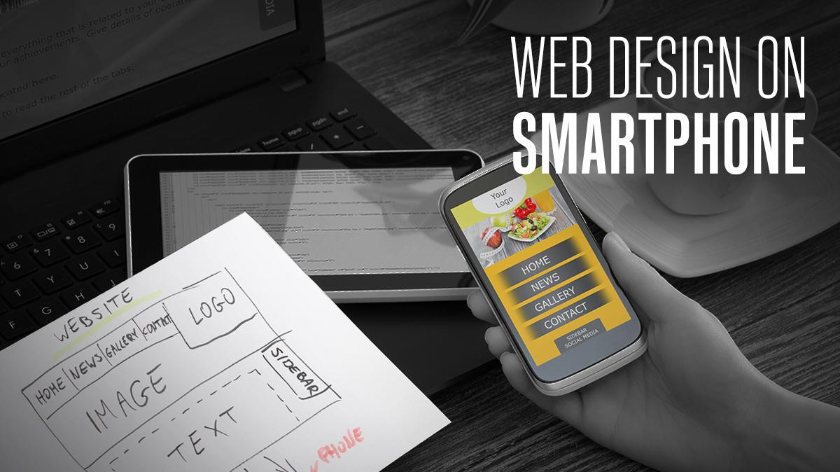 web design on smartphone sketch on paper